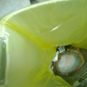 A hole poked at the top of the trash bag to avoid an air pocket.