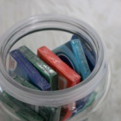 A jar filled with chewing gum packets.