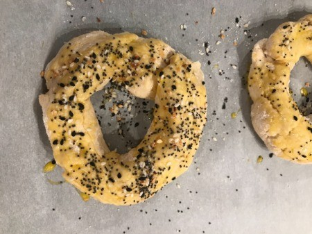 bagels with egg and seeds on top