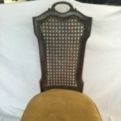 Identifying a Cane Back Chair - dark wood chair with upholstered seat and narrow cane back