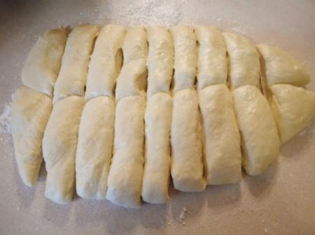 cutting rolls from flattened dough