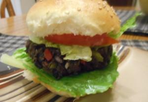 Black Bean Veggie Burger in bun with tomato and lettuce