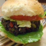 Black Bean Veggie Burger in bun with tomato and lettuce