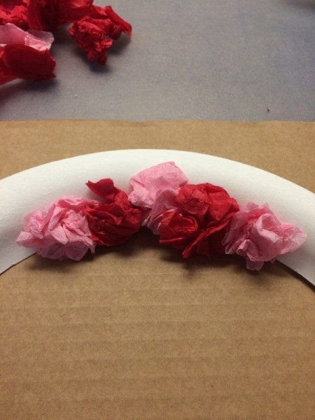 Valentine's Day Tissue Wreath - closeup of gluing on paper crumples