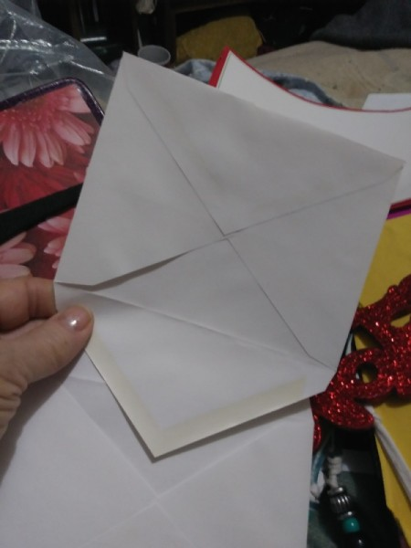 Make a Junk Journal Out of Envelopes - place flap into the next envelope