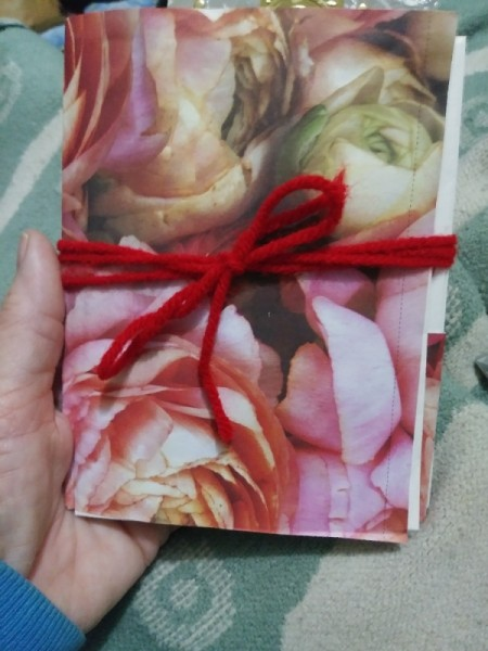 Make a Junk Journal Out of Envelopes - journal with a yarn bow