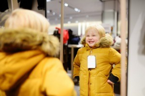 Kid Trying on Coat at Store
