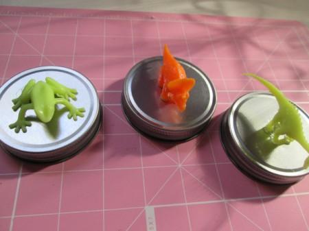 Glass Jar Party Favors - three plastic animals glued to three lids