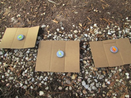 Glass Jar Party Favors - lids separated onto pieces of cardboard