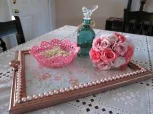 A decorative tray made from a wooden picture frame.