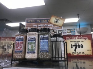 A row of complimentary seasonings at the meat market in a supermarket.