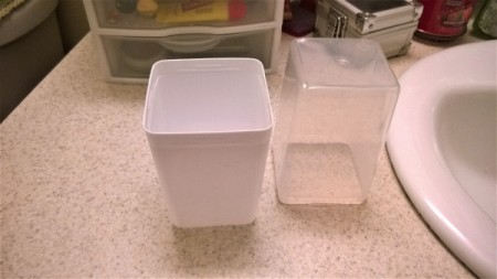 A recycled white plastic container with a large clear lid.