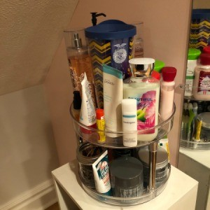 A lazy susan full of beauty products.
