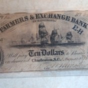 1833 Farmers Exchange 10 note in poor condition.
