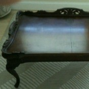 Value of Glass Top Mersman Table - dark wood ornate table