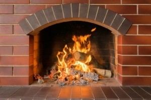 Brick Fireplace with Fire Burning