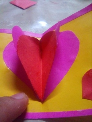 A homemade Valentine's Day card with pop-up hearts.