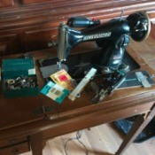 Manual for a Precision Deluxe Sewing Machine - vintage sewing machine in cabient