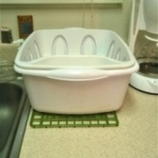 Raising a Dishwdrying Tub  - sink mat under the tub
