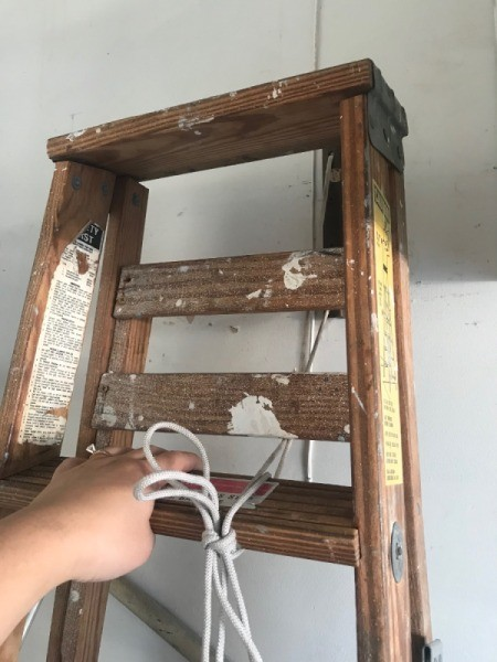 Safe Ladder Storage - tying ladder with rope