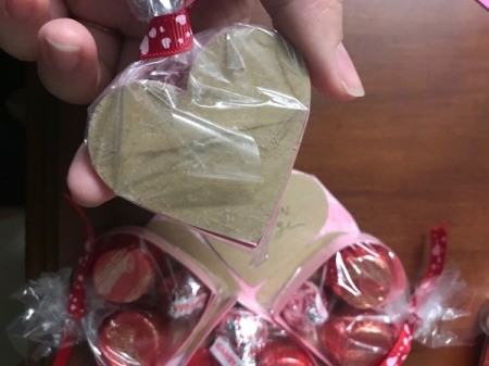 Valentine's Heart Chocolate Candy/Coupon Gift - tape the individual bags of boxed candy down over the coupons