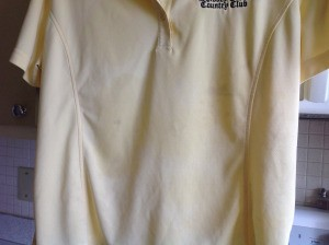 A golf shirt with stains.