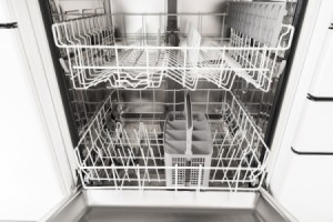 An empty dishwasher with the door open.
