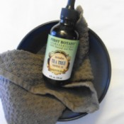 Tea Tree Oil in Bowl With Cloth
