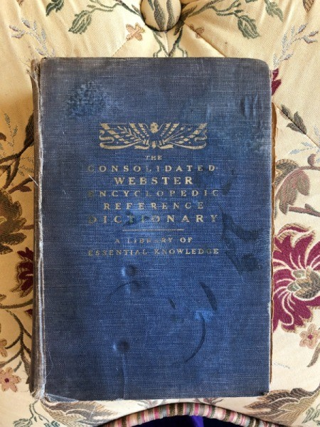 Value of Consolidated Webster's Reference Dictionary - worn blue fabric covered dictionary