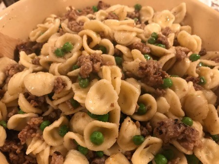 pasta mixed with sausage pea mixture