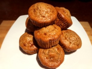Flourless PB Chocolate Chunk Protein Muffins piled on board