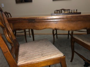 An oak table with chairs.