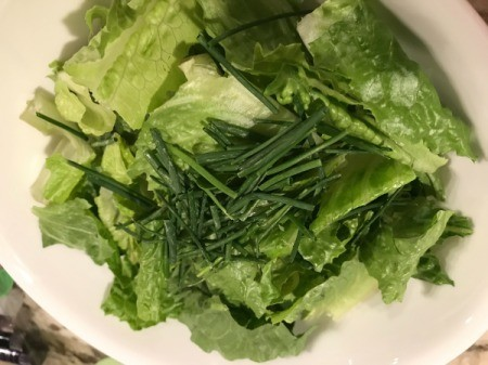 washed lettuce and chives in bowl