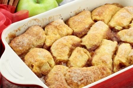 Baked Apple Dumplings in a red baking dish.