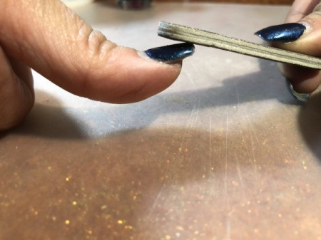 Trimming and Upkeep of Acrylic Nails - diagonally file down the tip for a more natural look