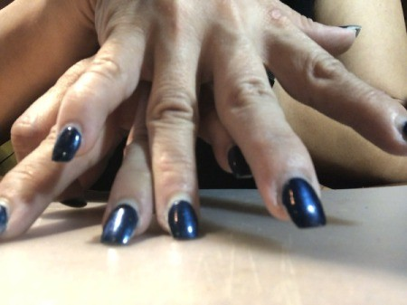 Trimming and Upkeep of Acrylic Nails - compare nails on both hands to make sure they are even