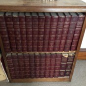 Value of 1768 Britannica Encyclopedia Set - volumes on bookcase shelves