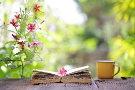 Book Flowers and Coffee Cup on Table
