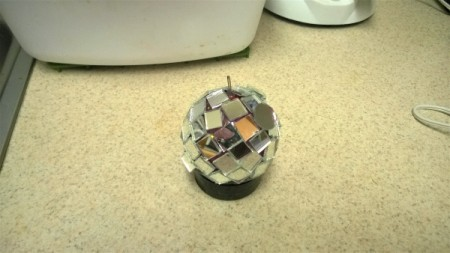 Mirror Ball for Cats - sit the ball inside the lid and finish gluing on the mirror pieces