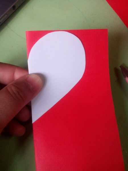 Pop Heart Decoration - using the white heart as a template cut out 12 half hearts from the red paper
