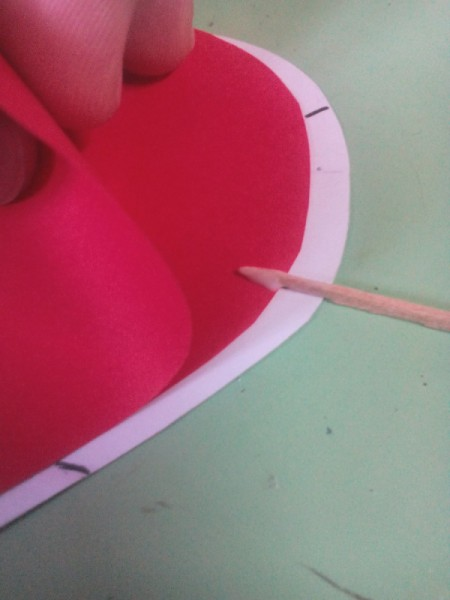 Pop Heart Decoration - use a toothpick to put a spot of glue inside the folded red heart at each mark