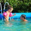 Kids Playing in Above Ground Swimming Pool