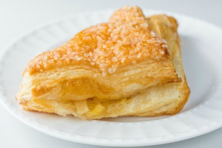 Apple turnover on a white plate.