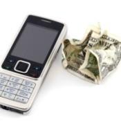 Cellphone next to a crumpled dollar bill.