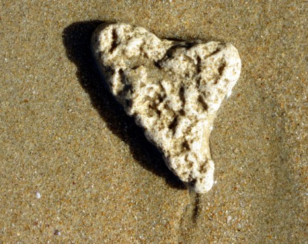 Heart-Shaped Stone - stone on a sandy beach