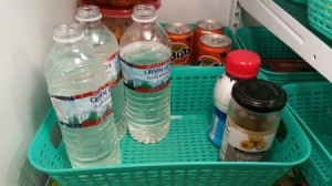 Refilled water bottles in the refrigerator.