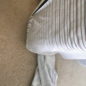 Using a towel to move a mattress.