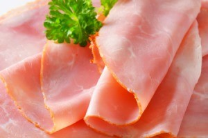 Closeup of sliced ham lunch meat.