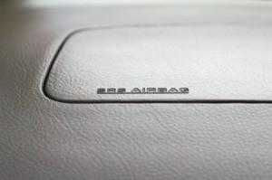 Closeup of a dashboard airbag.