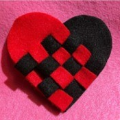 Woven Felt Heart - closeup of finished heart on dark pink background